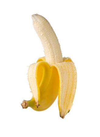 Single fresh, yellow, ripe banana half peeled over white background