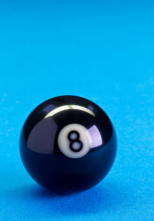 Billiard pool game eight ball on billiard table with blue cloth, copy space