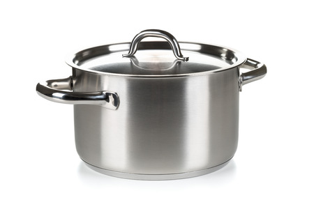 Open stainless steel cooking pot with lid over white background