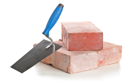 Trowel with bricks isolated on a white background - Home construction or renovation concept Imagens