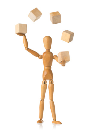 Wooden mannequin figure juggling wooden blocks over white background - project management or complex resource handling concept