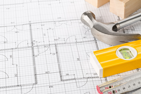 Construction tools and wooden strips on architectural blueprint house building plan on table with copy space 写真素材