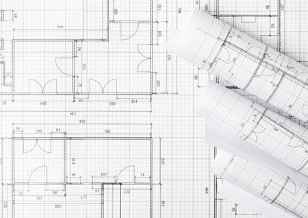 Rolls of architectural blueprint house building plans on blueprint background on table flatlay top view from above Stockfoto
