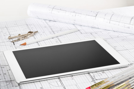 Tablet pc architectural blueprint house building plan with pencil, compasses and folding rule