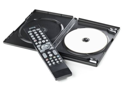 DVD, CD-ROM disc with tv or disc player remote control and plastic box on white background. Home theatre movie or series concept.