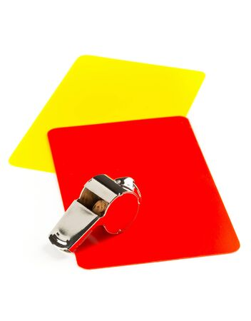 Soccer sports referee yellow and red cards with chrome whistle on white background - penalty, foul or sports concept Archivio Fotografico