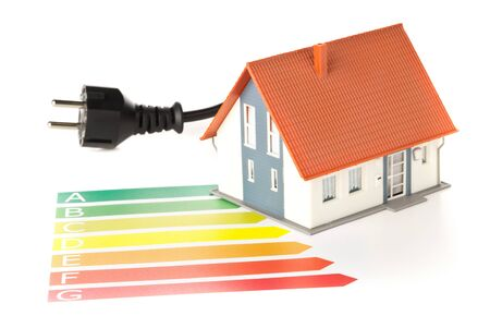 European energy classification labels with power cord, plug and model house on white background - energy saving or power consumption concept