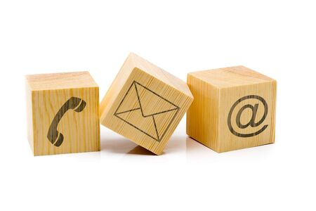 Contact us symbols with phone, e-mail and envelope icons on three cubes on white background