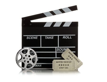 Single, black, open movie clapper or clapper-board with film reel and movie theatre tickets on white background