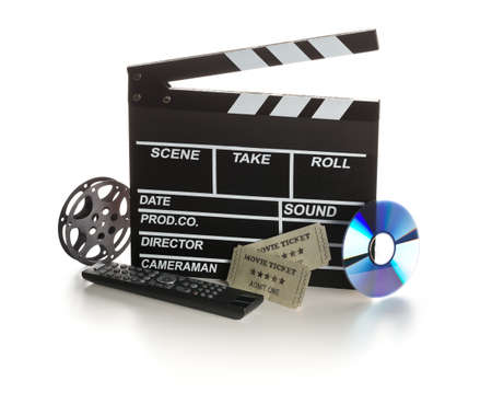 Single, black, open movie clapper or clapper-board with dvd movie disc, film reel, remote control and movie theater tickets on white background - digital movie, home cinema or movie night concept