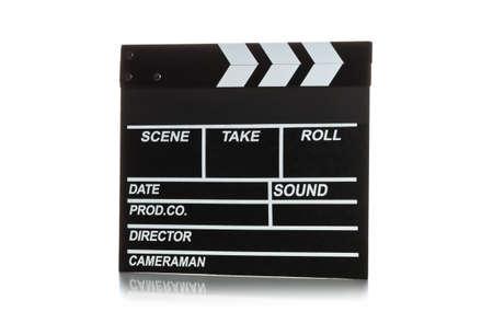 Single, black, closed movie clapper or clapper-board over white background 版權商用圖片