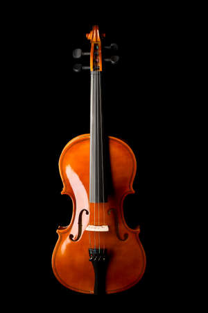 Brown wooden fiddle or violin, classic musical instrument, isolated over black background, flat lay top view from above