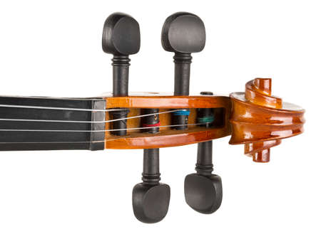 Close up macro of scroll on brown wooden fiddle or violin, classic musical instrument, isolated on white background, selective focus, top view Zdjęcie Seryjne