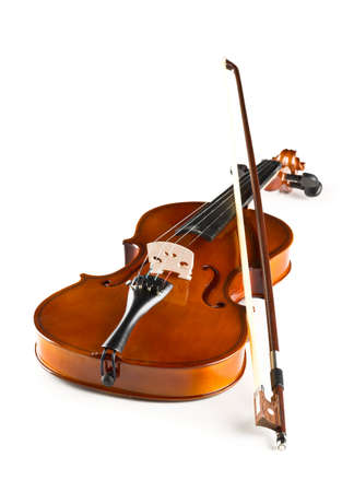 Brown wooden fiddle or violin, classic musical instrument, with bow over white background, selective focus