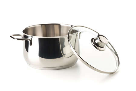 Open, empty stainless steel cooking pot with glass lid over white background, cooking or kitchen utensil, selective focus Archivio Fotografico