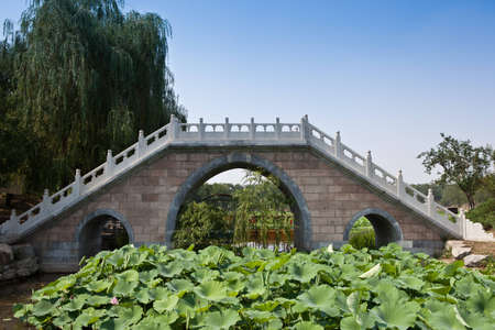 A chinese style stone bridge in the The Old Summer Palace   photo
