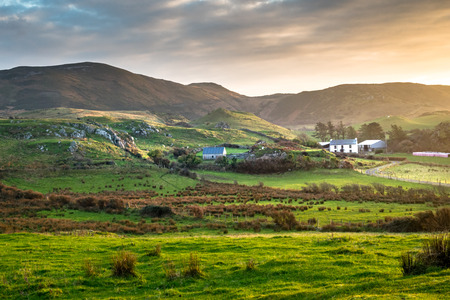 This is a picture of a farm house in a remote valley near the sea in northern Donegal Ireland Stock Photo