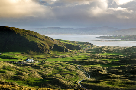 This is a picture of the green rolling hills of Donegal Ireland.  It was taken at five finger strand.