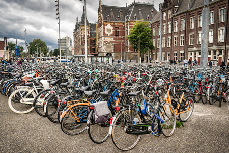 This is a picture of hundres of bicycles locked up outside of the train station in Amsterdam Imagens