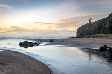 This is Mussenden Temple at Downhill on the Antrim Coast in Northern Ireland.  The picture was taken at sunset 版權商用圖片