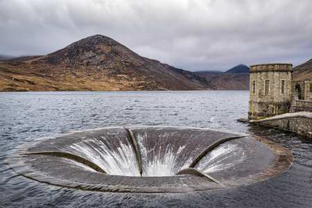 This is a picture of the overflow drain in the Silent Valley Reservoir.  The reservoir is in the Mourne mountains of Northern Ireland