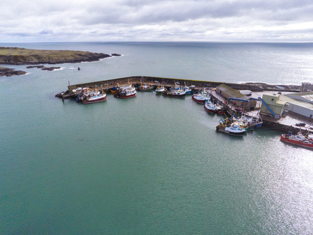 This is an aerial view of Ardglass harbour and fishing boat fleet in County Down Northern Ireland