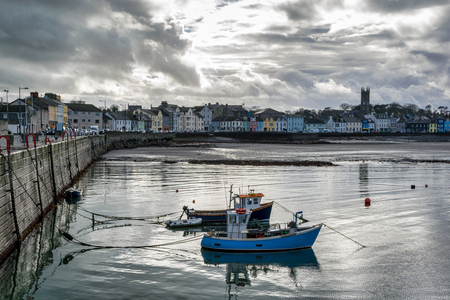 This is Donaghadee Harbour and Lighthouse on the east coast of Northern Ireland.  Fishing boats are anchored in the calm water