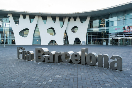 Barcelona, Spain - April 9, 2019:  One of the entrances and the sign for the Fira Barcelona convention center. 新聞圖片