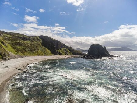 This is a remote stony beach at Malin Head in Donegal Ireland Stock Photo