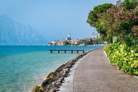 Malcesine, Italy - July 24, 2019: A foot and cycle path that leads to Malcesine village on Lake garda
