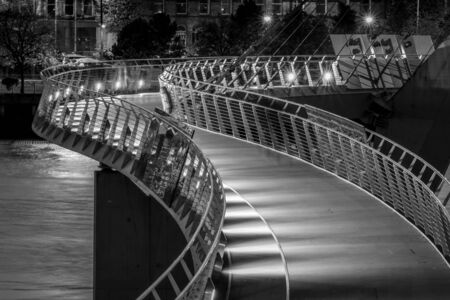 This is a black and white photograph of the Peace Bridge in Derry Northern Ireland