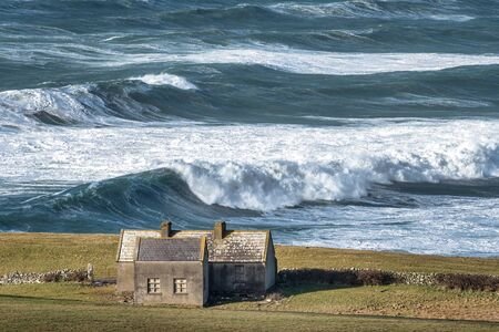 Rough sea with large waves on the Irish coastline in County Clare near the Cliffs of Moher