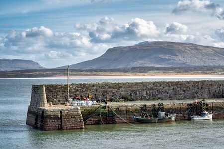 Mullaghmore Harbour wall and moored fishing boats