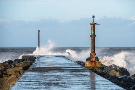 Ocean waves crashing on the end of the Barmouth in Castlerock, Norther Ireland Reklamní fotografie