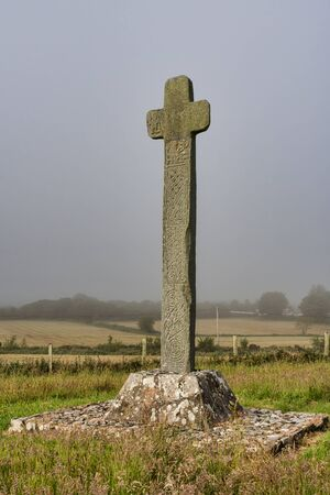 Cloncha High Cross in county Donegal Ireland. This picture was taken on a foggy morning