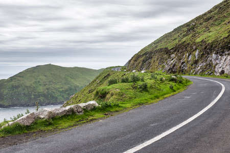 Curving cliff side road to Keem Bay on Achill Island