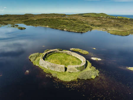 An aerial view of Doon Ring Fort on an island in Doon lake on the west coast of Donegal Ireland