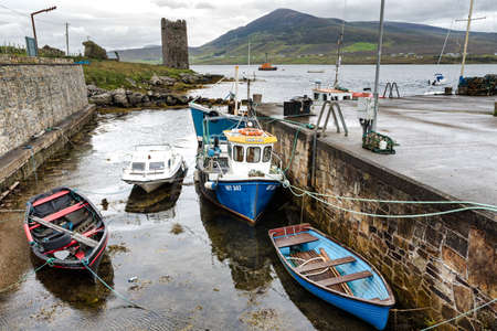 Achill, Ireland- Jul 30, 2020: The small pier at Cloughmore overlooking Kildavnet Castle on Achill Island County Mayo in Ireland
