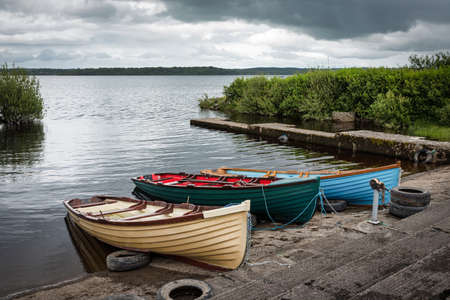 Wooden rowboats in a small marina on lake Melvin in County Leitrim Ireland