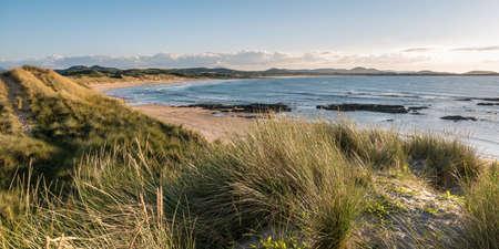 Sand dunes covered in grass on Ballyheirnan Beach in Donegal Ireland Stock fotó