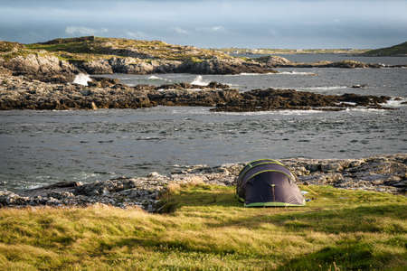 Tent pitched by the ocean on the west coast of Ireland