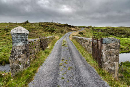 A stone bridge goining over a stream in rural county Galway Ireland Stock fotó