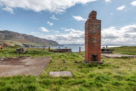 The ruins of Lenan Head fort on the north coast of County Donegal Ireland.  It was used to guard Lough Swilly.  All that is left of most of the building is the chimney
