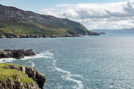 The rugged mountaines coastline on the entrance to Lough Swilly in County Donegal Ireland