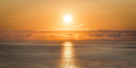Sunrise on the Irish ocean just off to coast of Ireland