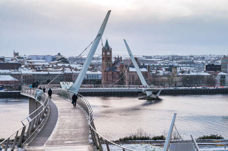 The Peace Bridge covered in snow in Derry, Northern Ireland Stock fotó
