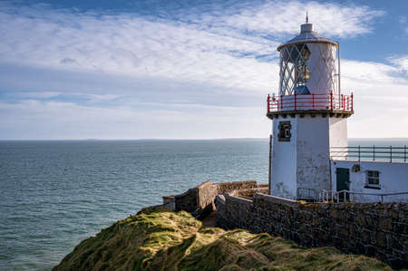 Blackhead Lighthouse high up on the coastal cliffs of Northern Ireland near the town of Whitehead Stock fotó
