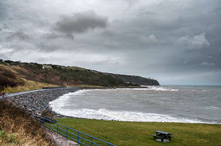 The Coast walk to Blackhead Lighthouse on a stormy winters day