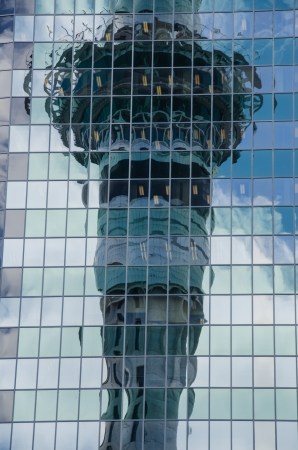 Sky tower reflection on glass building, Auckland, New Zealand