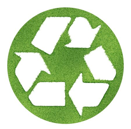 Recycle symbol made on grass outlines. Stock Photo